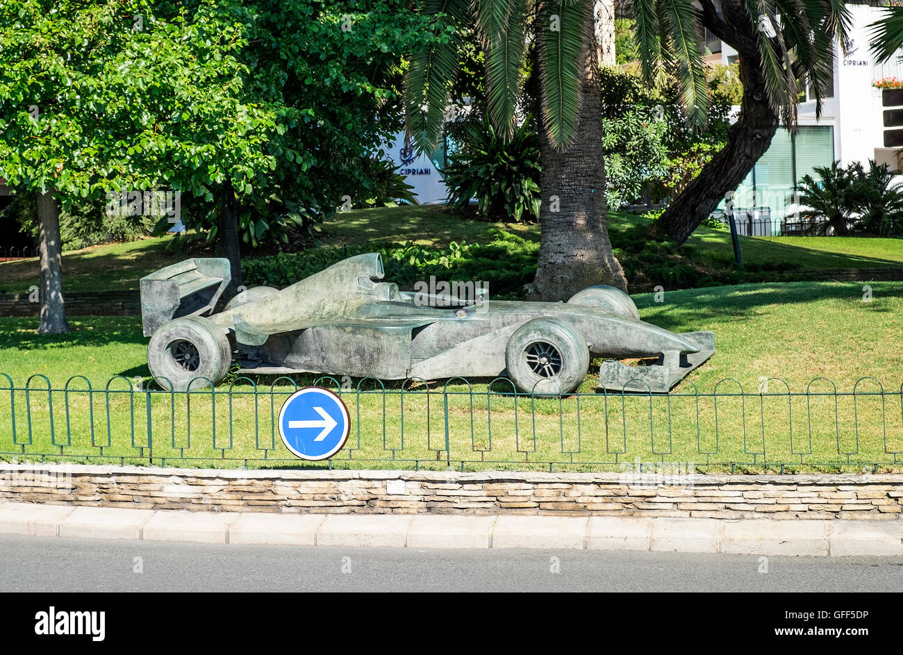 A bronze Formula 1 car, one of a series of racing car statues around the Grand Prix circuit in Monte Carlo, Monaco - Stock Image