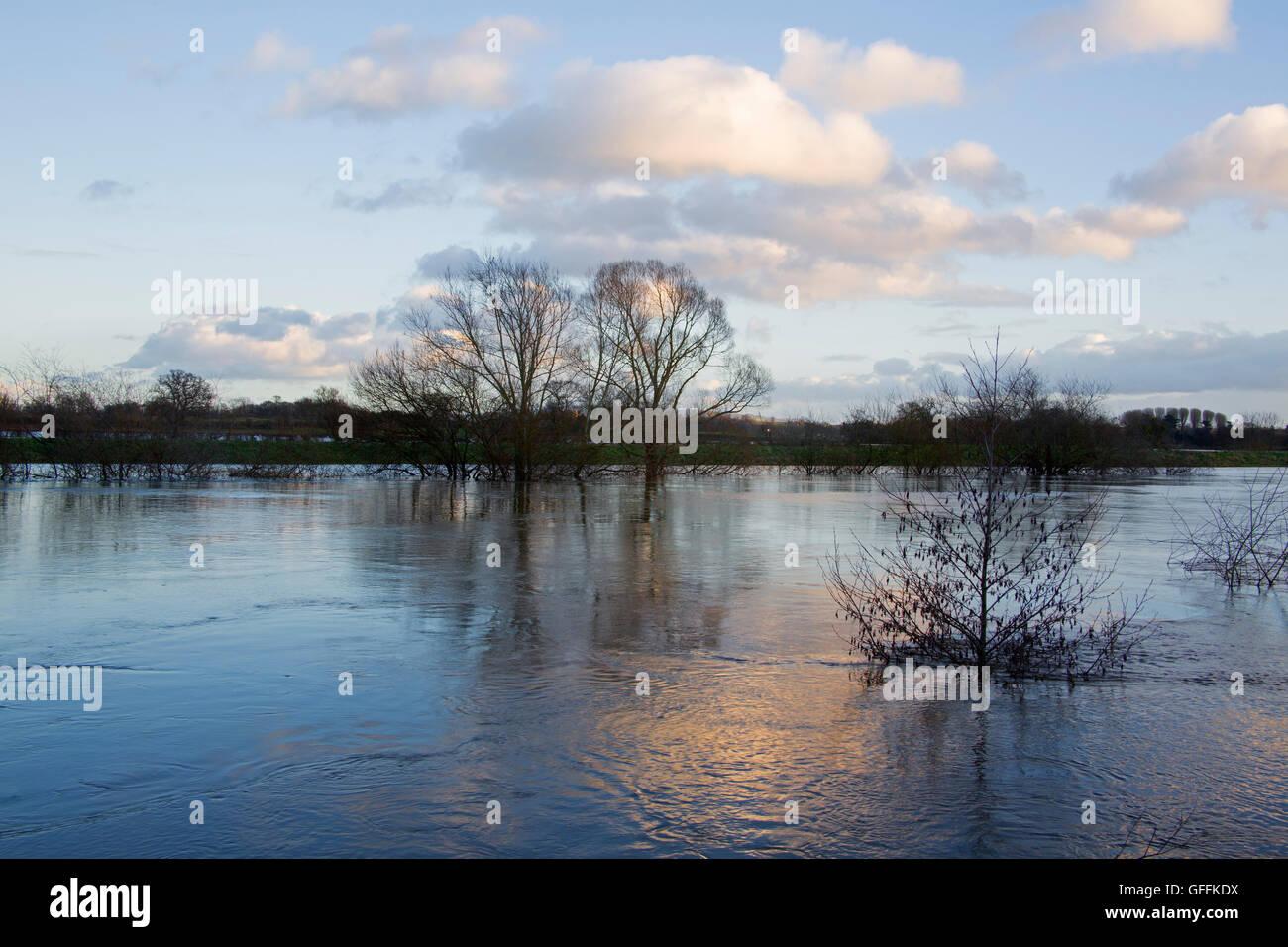 River Severn overflowing onto flood plain. Worcestershire, UK - Stock Image