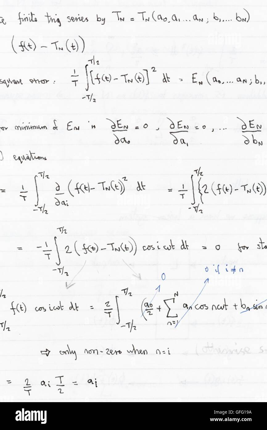 Mathematical equations and formulae in a notebook - Stock Image