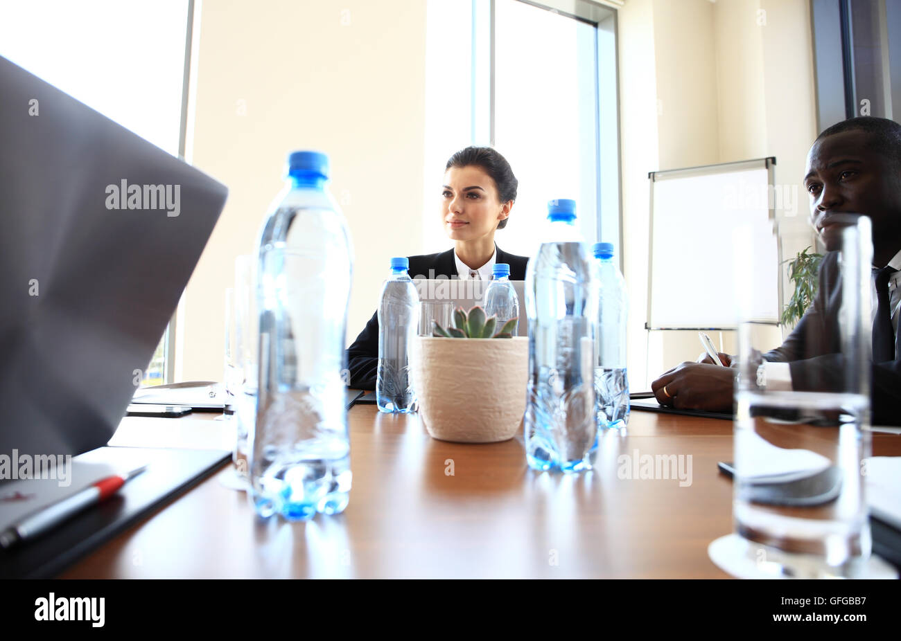 A group of successful businessmen. Discussion of the important contract of company. - Stock Image