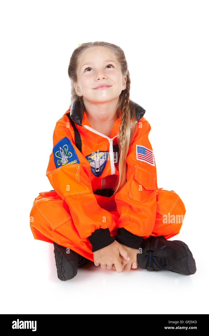 Little girl costumed as an Astronaut.  Isolated on white background. - Stock Image