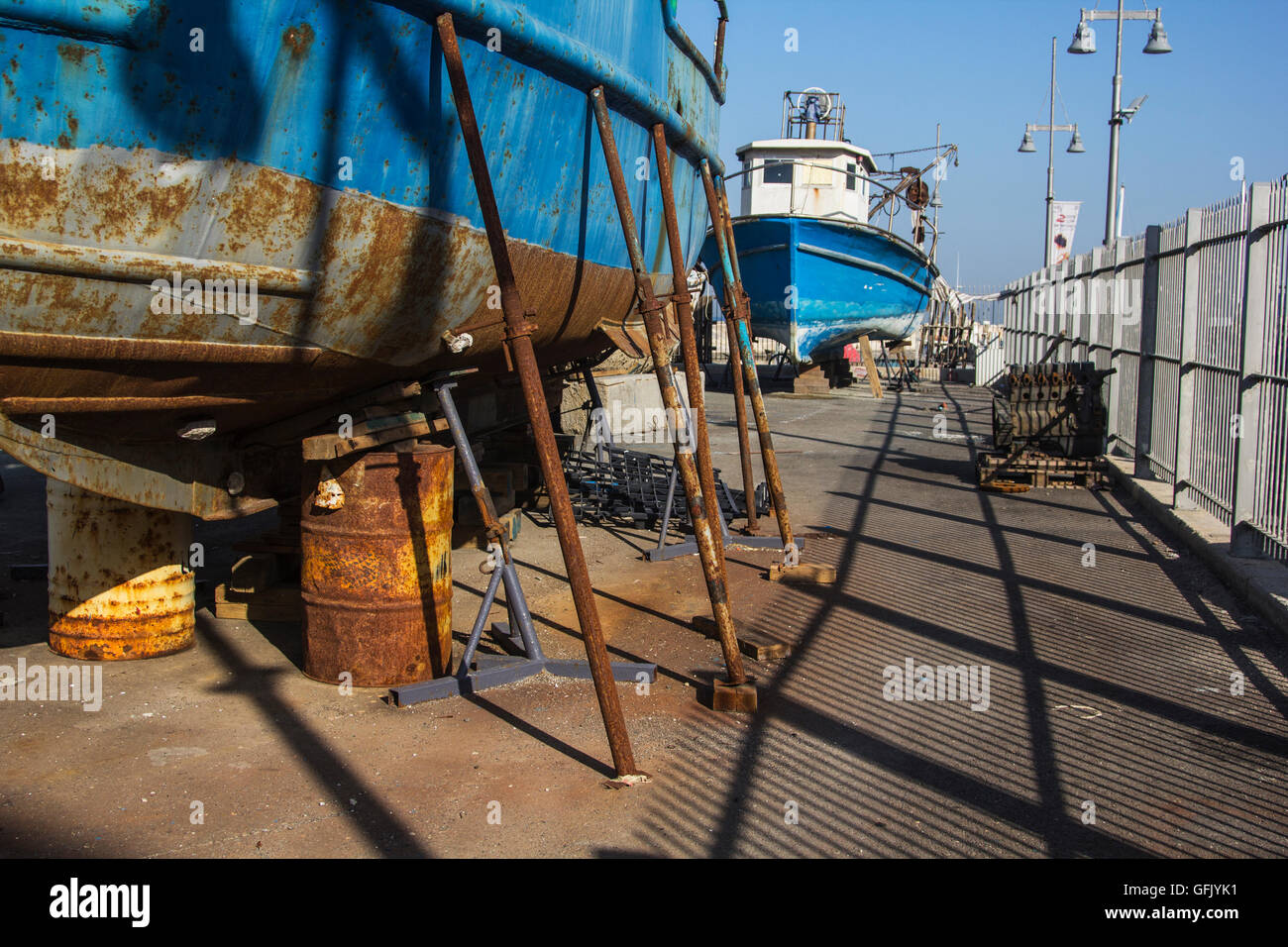 abandoned old ship full of rust and mold on the inland port area, - Stock Image