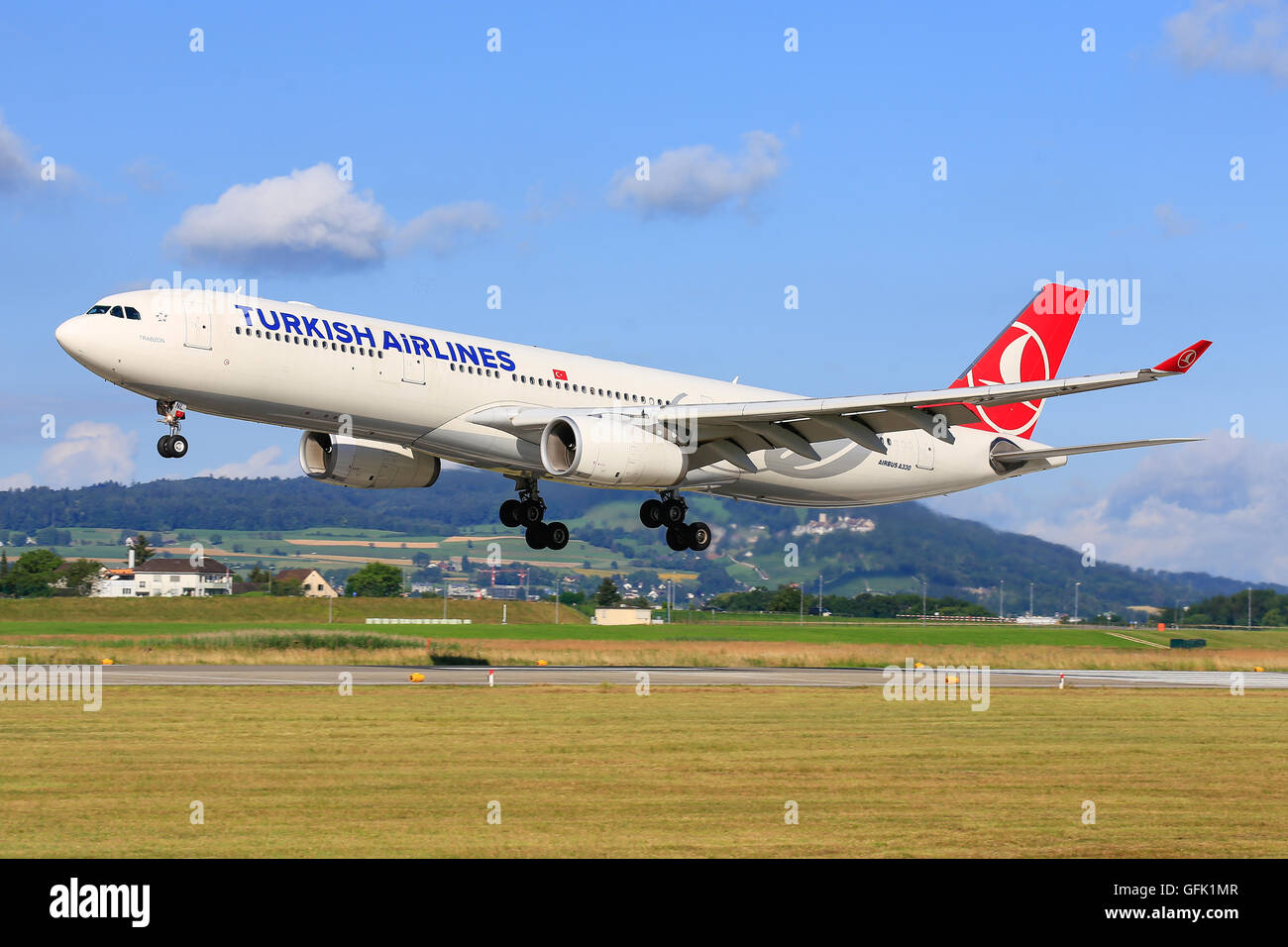 urich/Switzerland July10, 2016: Turkish Airliners Airbus A330 landing at Zurich Airport. - Stock Image