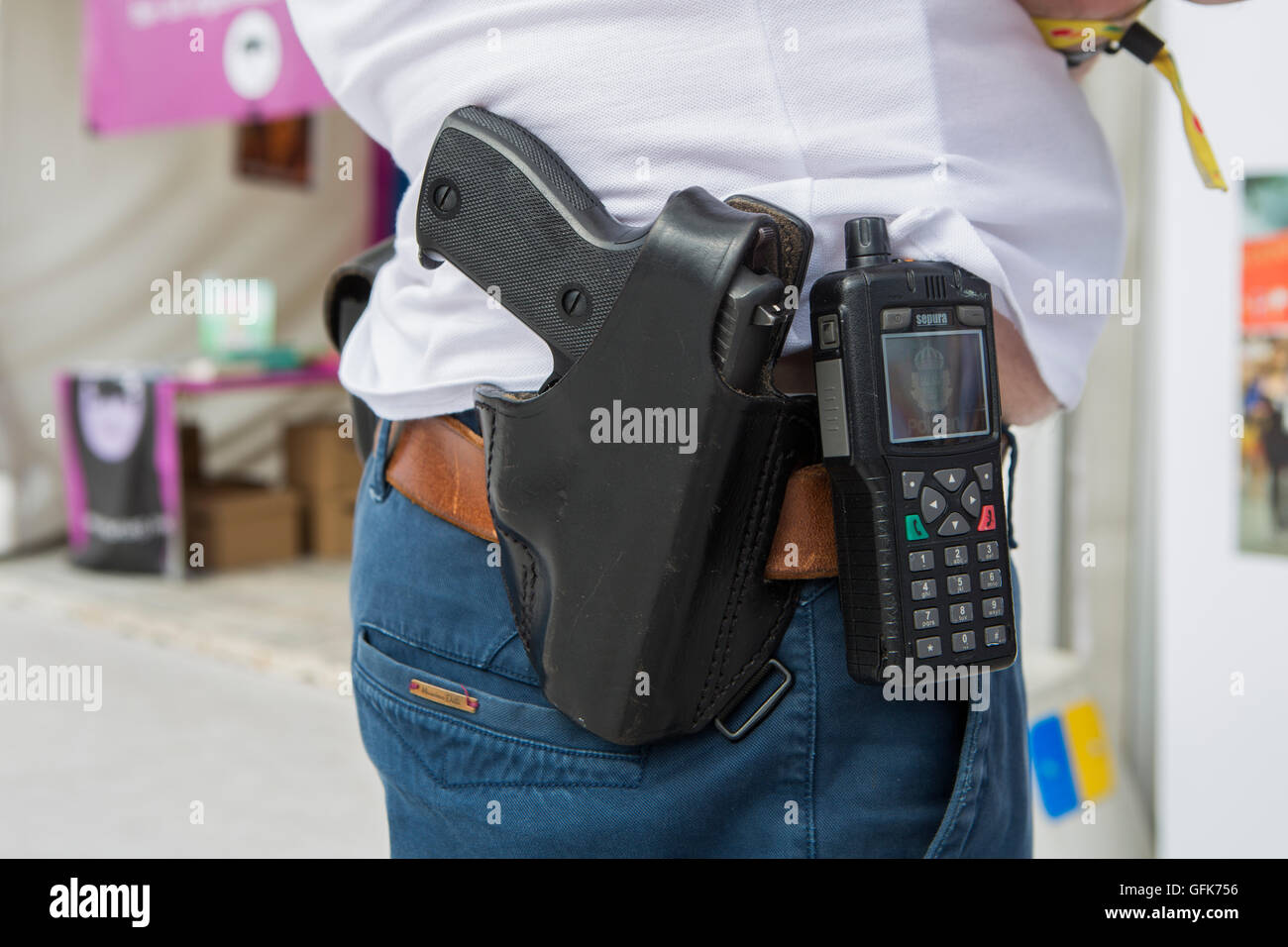 Civilian police with his service weapon. - Stock Image