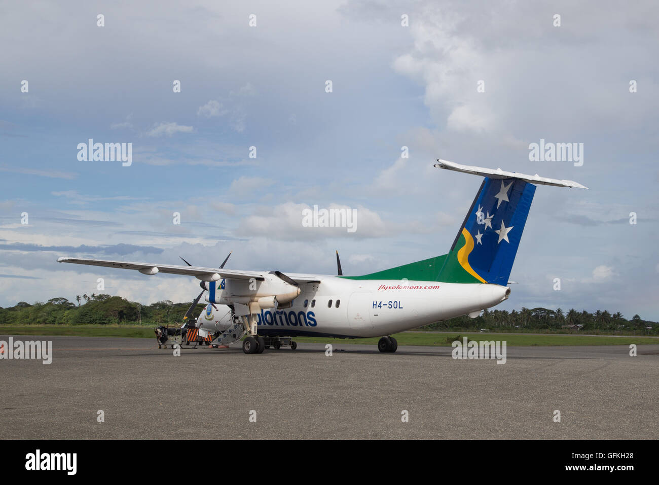 Honiara, Solomon Islands - May 27, 2015: Small propeller plane parked at the airport - Stock Image