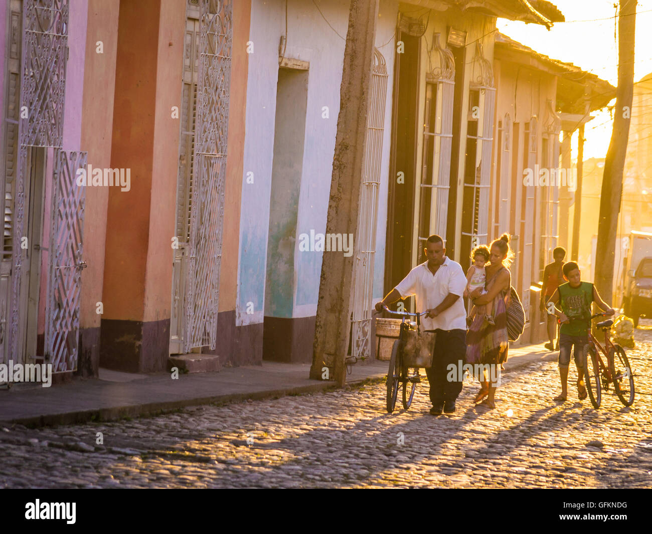 Trinidad, Cuba on December 29, 2015: The warm sunset light shines on the streets of the city centre in the Cuban - Stock Image