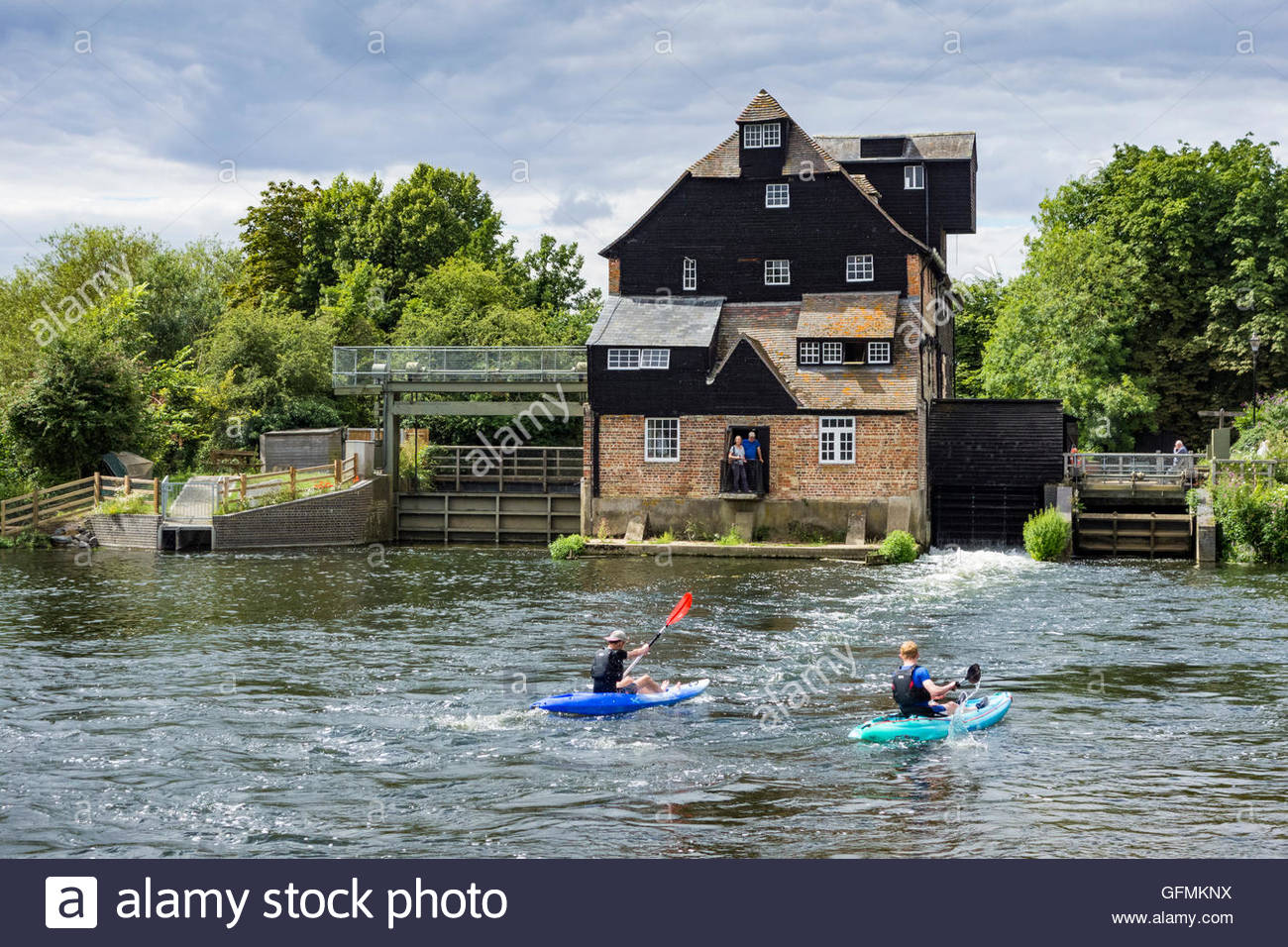 Houghton, Cambridgeshire, UK. 31st July, 2016. Kayakers on the River Great Ouse by  Houghton Water Mill in Cambridgeshire, - Stock Image
