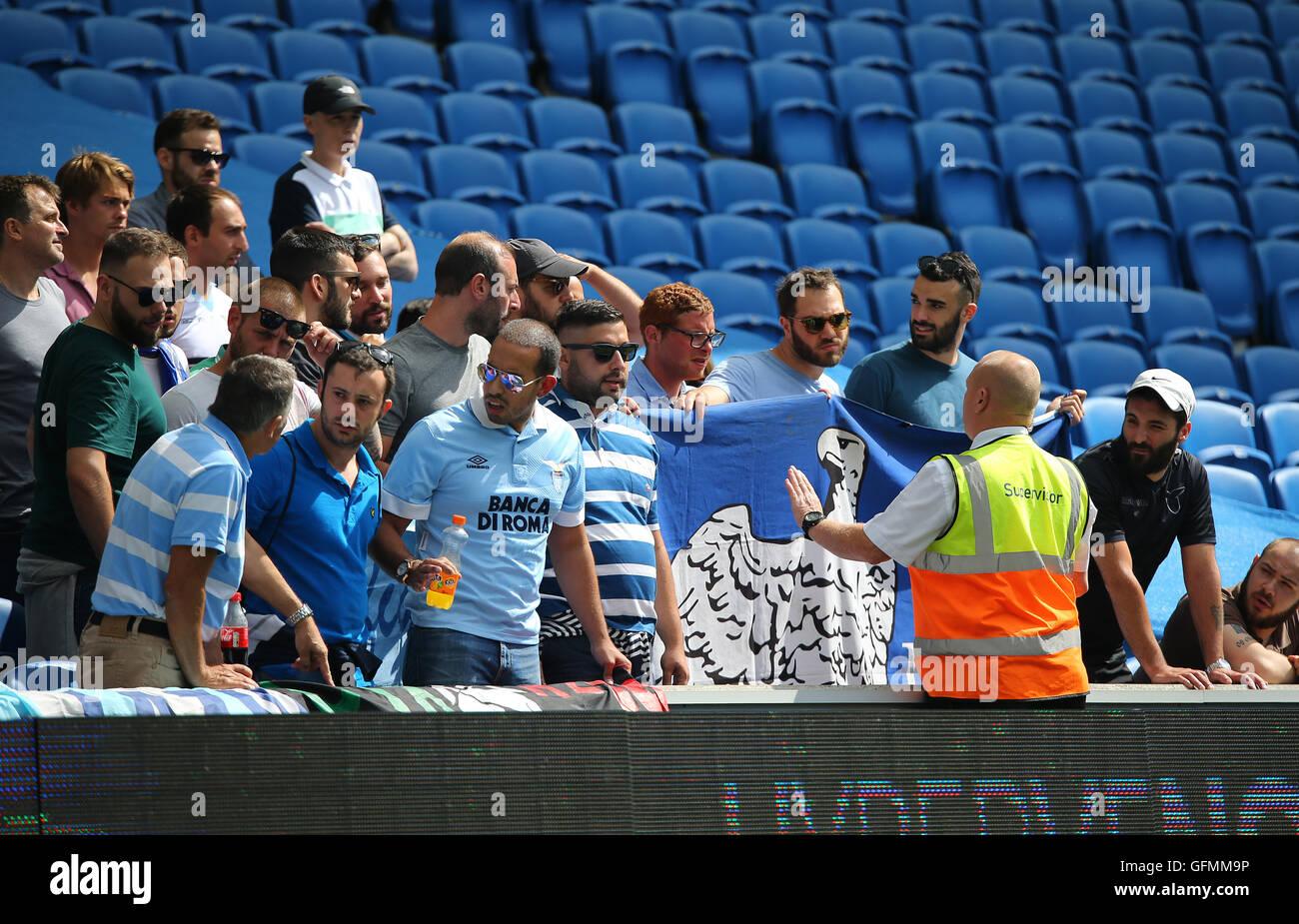 American Express Stadium, Brighton, Great Britain. 31st July 2016. Lazio fans speak with a steward during a Pre Stock Photo