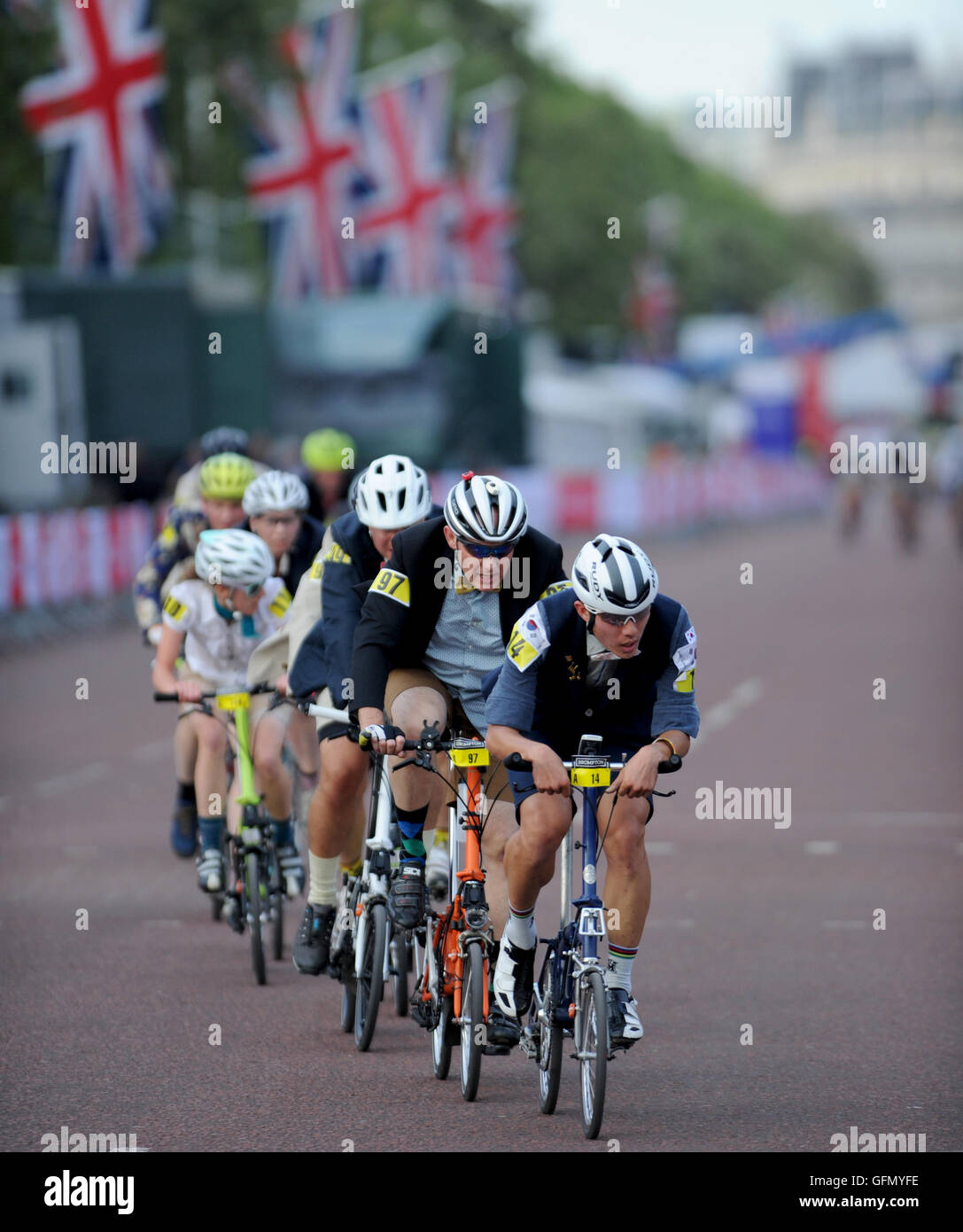 Central London, UK, 30th July 2016. Brompton World Championship Final. Riders race down The Mall during the Brompton Stock Photo