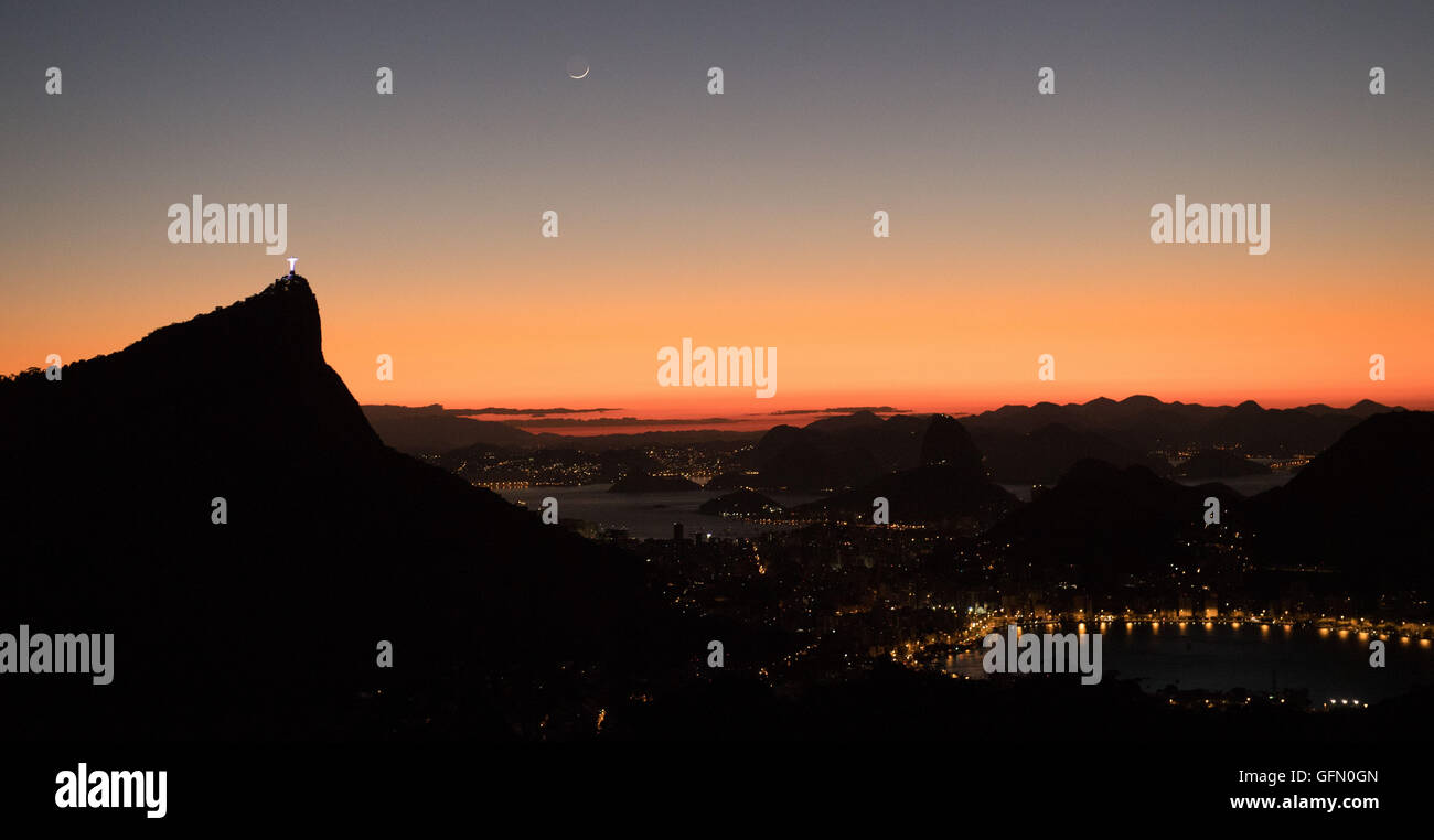 August. 01st Aug, 2016. Christ the Redeemer is seen during sunrise from the viewpoint Vista Chinesa in Rio de Janiero, Stock Photo
