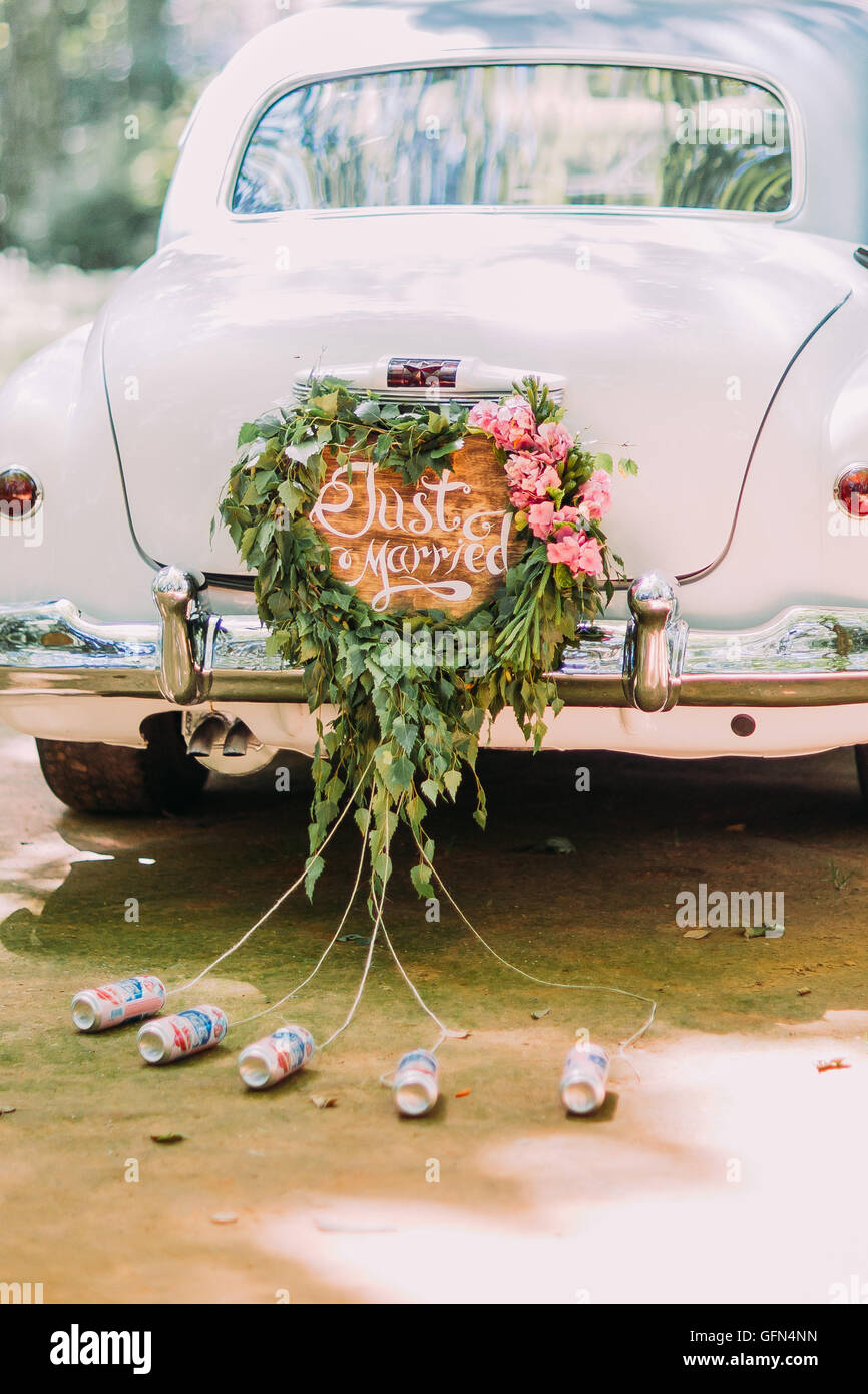 Vintage wedding car with just married sign and cans attached Stock ...
