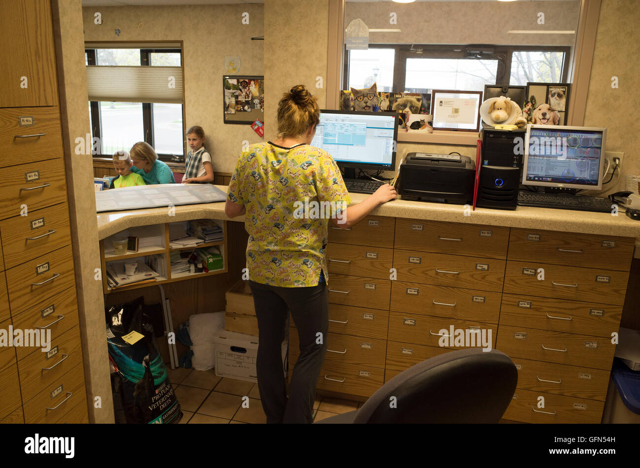 Family waiting in the office of the Highland Animal Hospital - Veterinarian Clinic. St Paul Minnesota MN USA - Stock Image