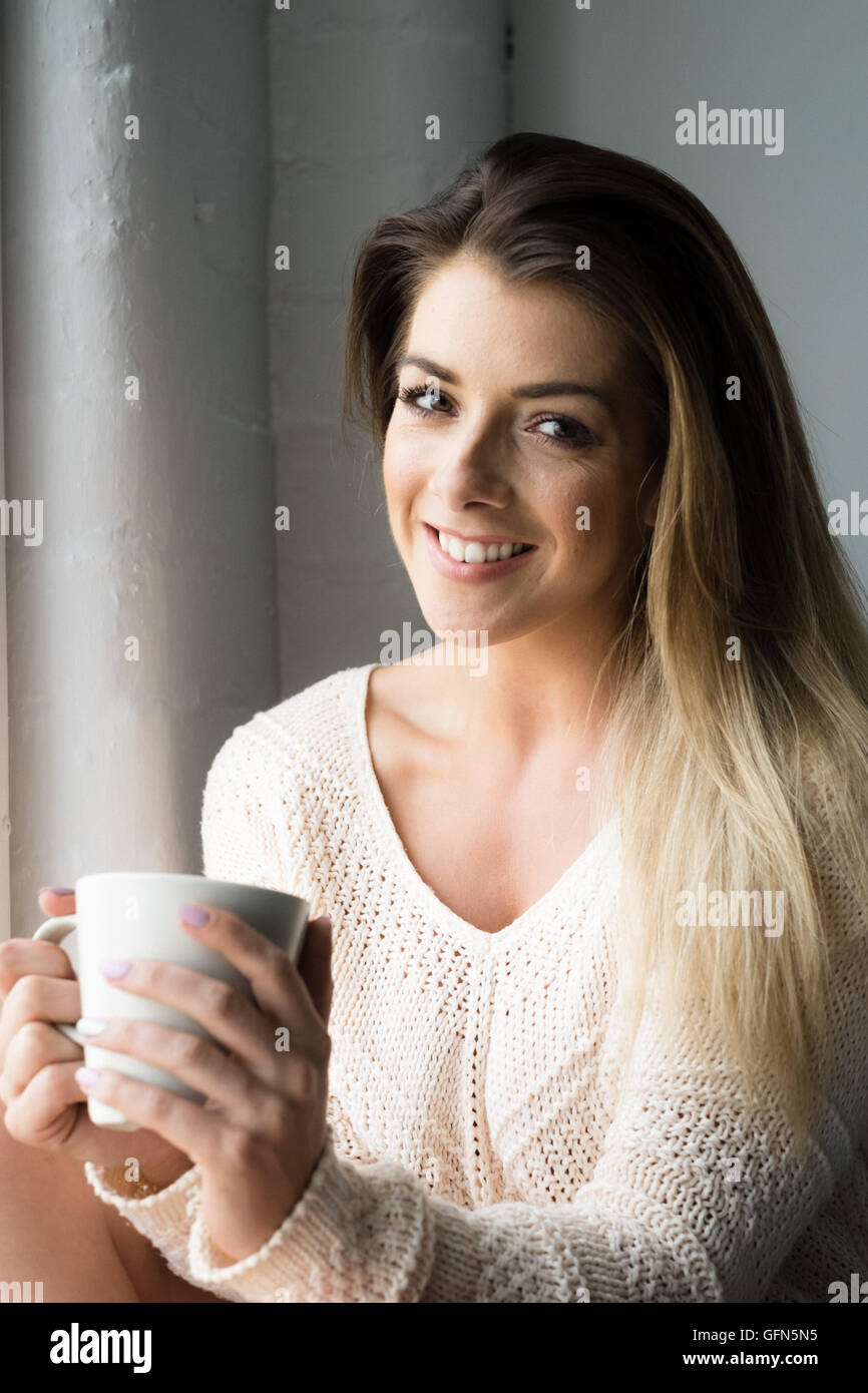Smiling beautiful young woman - Stock Image