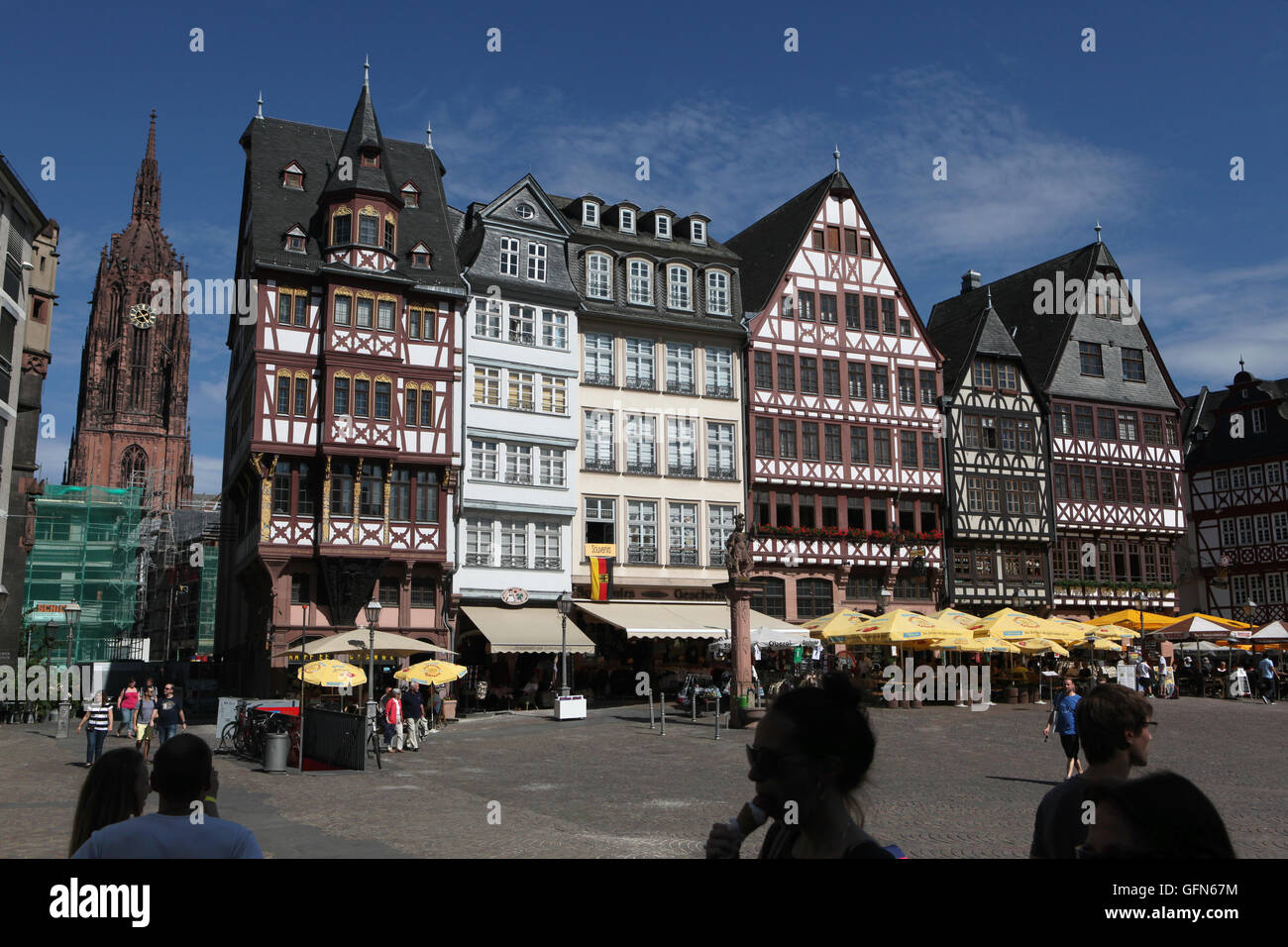 Tourists in front of the reconstructed half-timbered houses of the Ostzeile at the Romerberg in Frankfurt am Main, Stock Photo