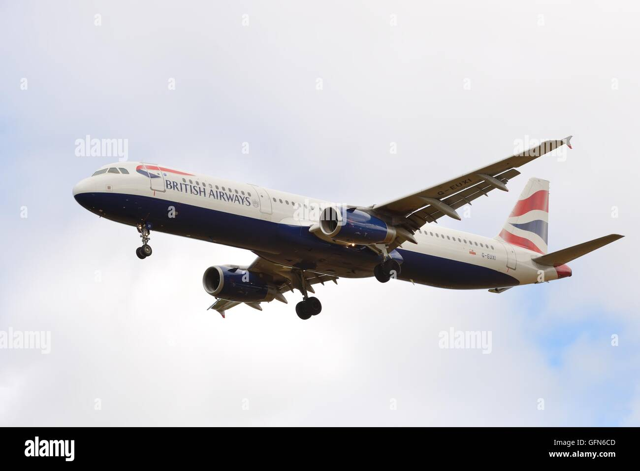 A British Airways Airbus A321 on final approach to the airfield in Glasgow, Scotland, UK - Stock Image