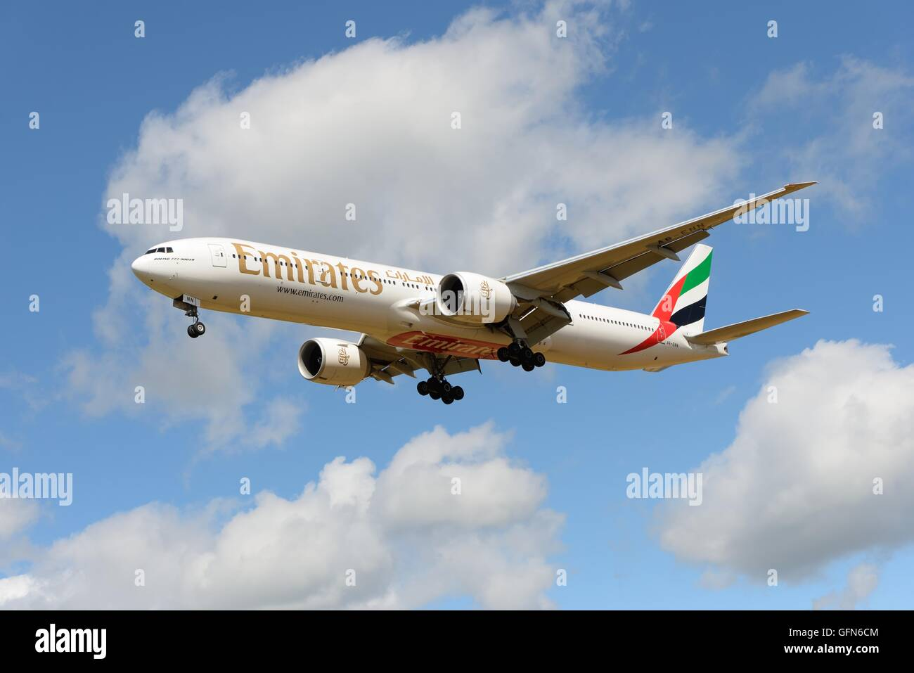 An Emirates Airlines Boeing 777-31HER on final approach to the airfield in Glasgow, Scotland, UK - Stock Image