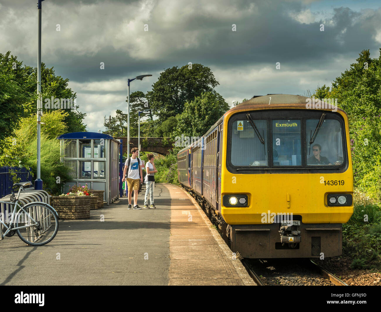 Passengers wait to board the First Great Western Train at Lympstone Station bound for Exmouth along the picturesque Stock Photo