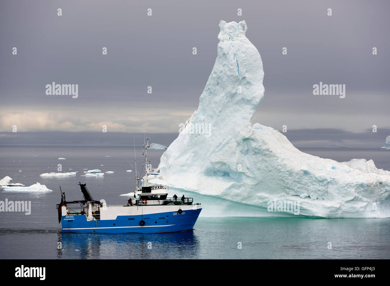 Fishing boat, icebert, Disko Bay, Ilulissat, Greenland - Stock Image
