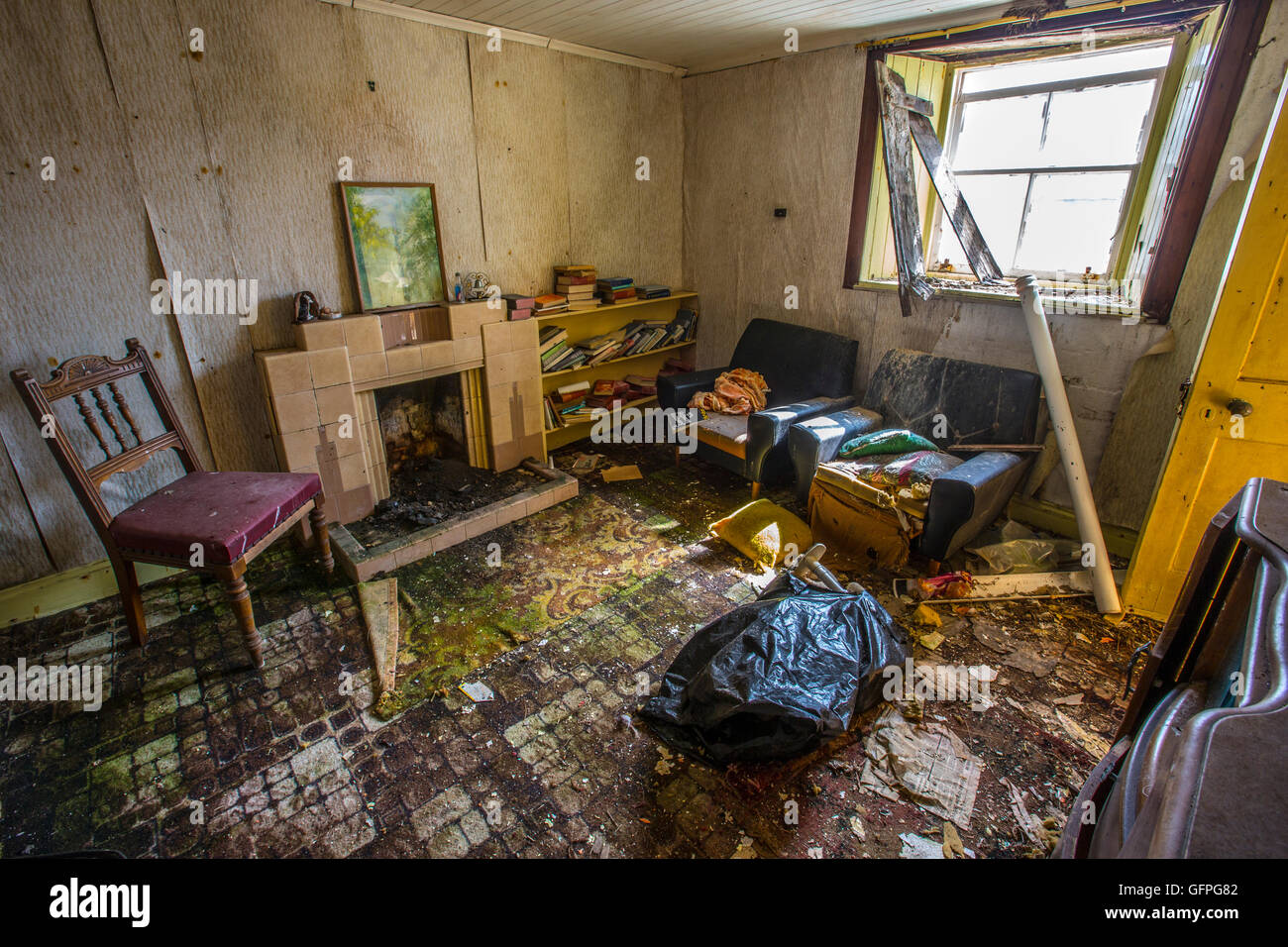 The living room of a derelict cottage. - Stock Image