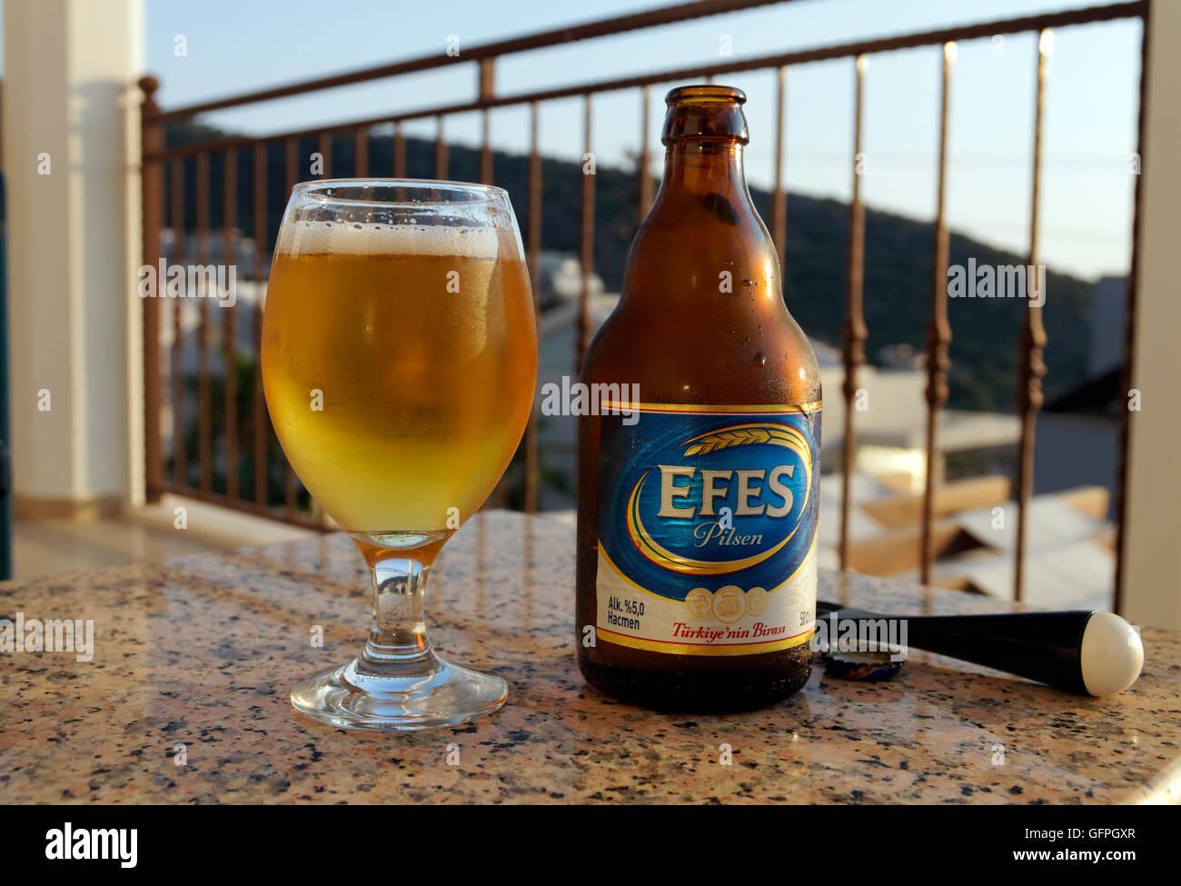 Bottle and glass of Efes Pilsen beer, Turkey. Stock Photo