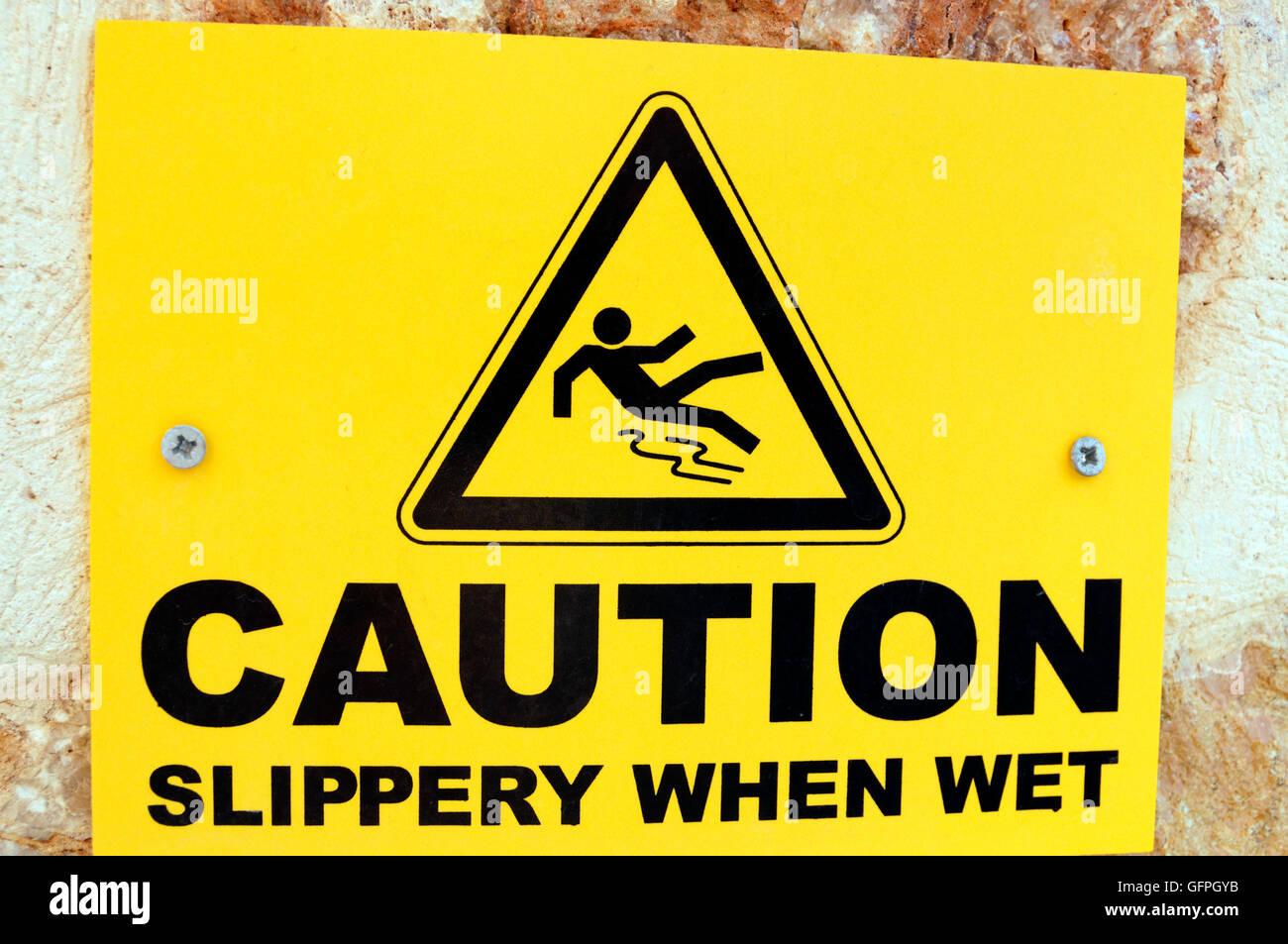 Warning sign for slippery surface, Kisla, Kalkan, Turkey. - Stock Image