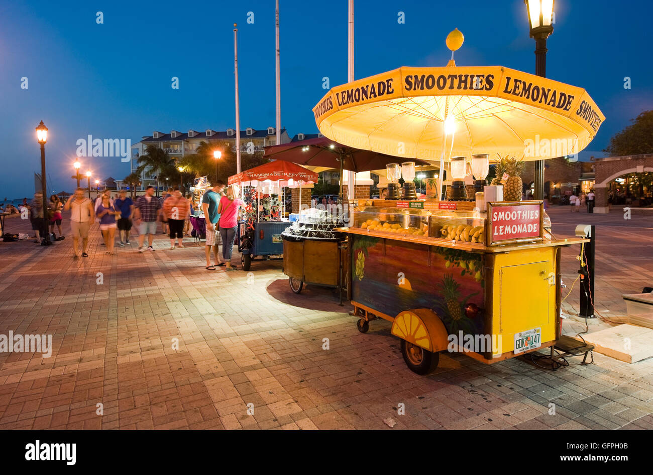 KEY WEST, FLORIDA, USA - MAY 03, 2016: Tourists are relaxing in the twilight on Mallory Square in Key West in Florida. - Stock Image
