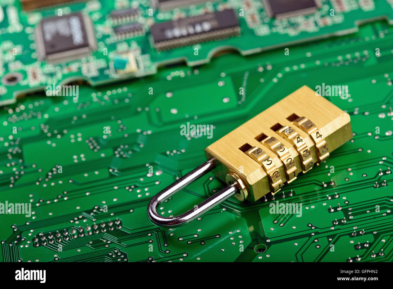 Computer Hardware security concept. Lock over circuit board - Stock Image