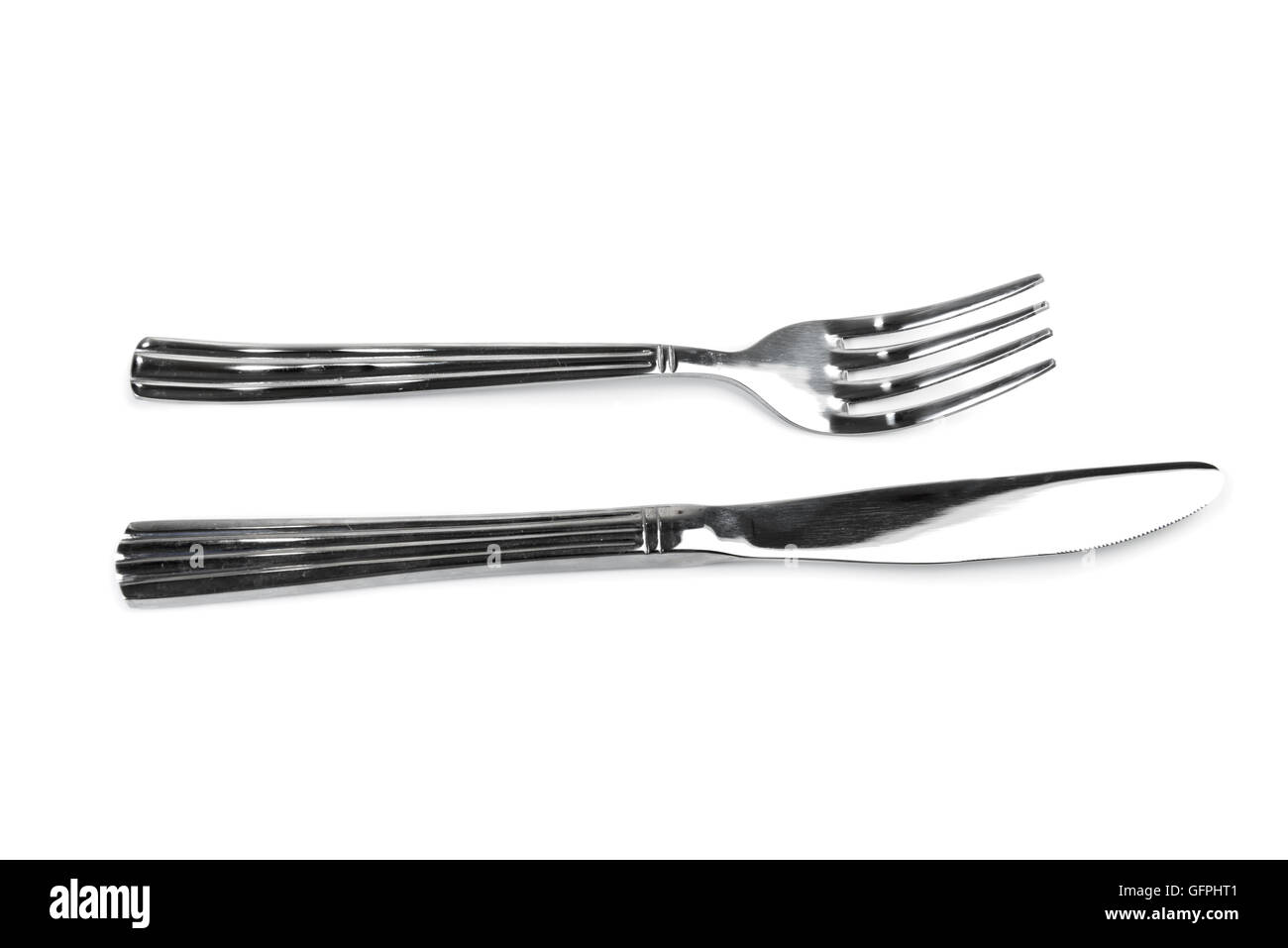Table knife and fork isolated over white background - Stock Image