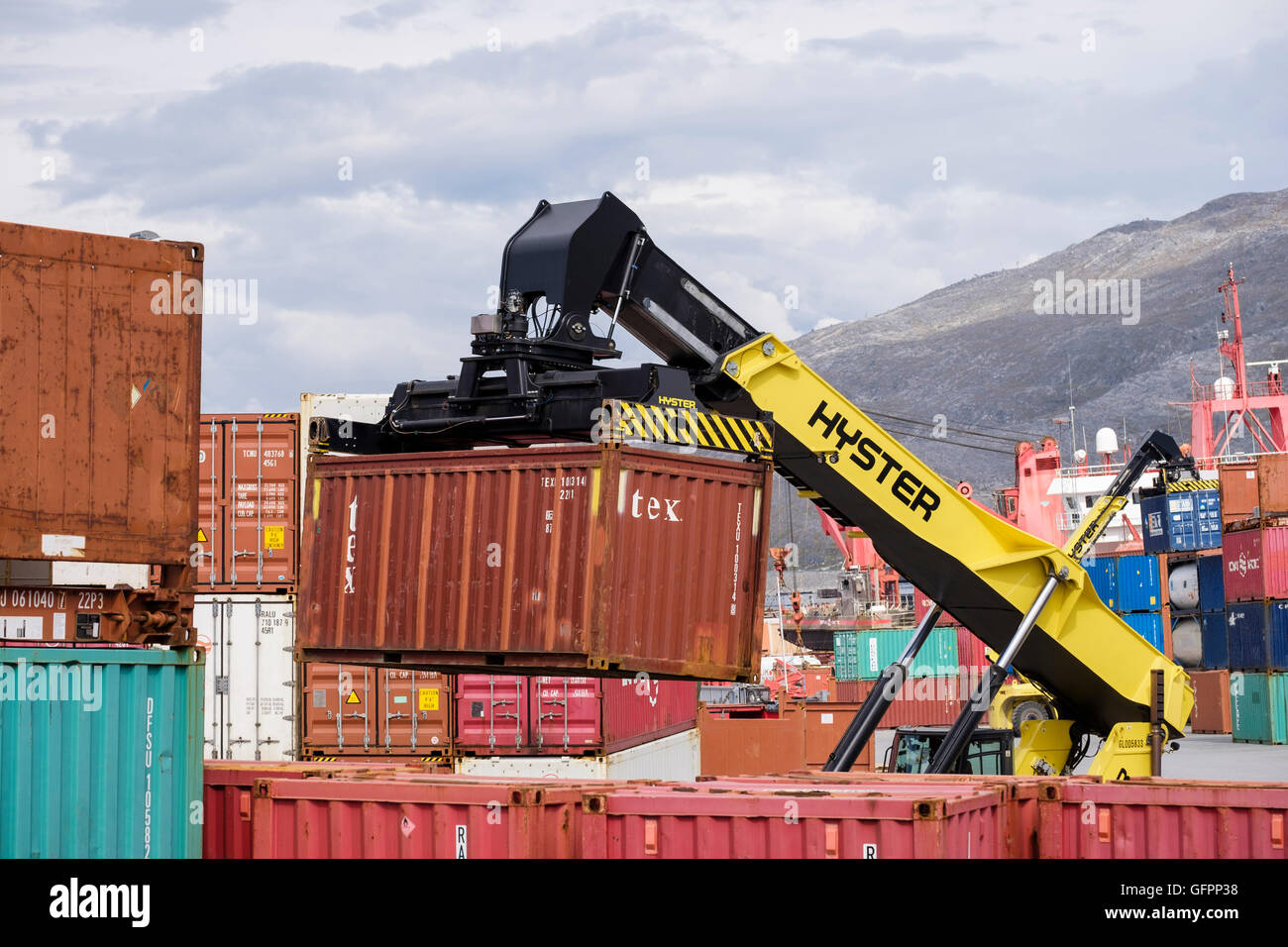 Hydraulic Hyster electric forklift truck lifting freight shipping containers in port. Atlantic Harbour Nuuk Sermersooq Stock Photo