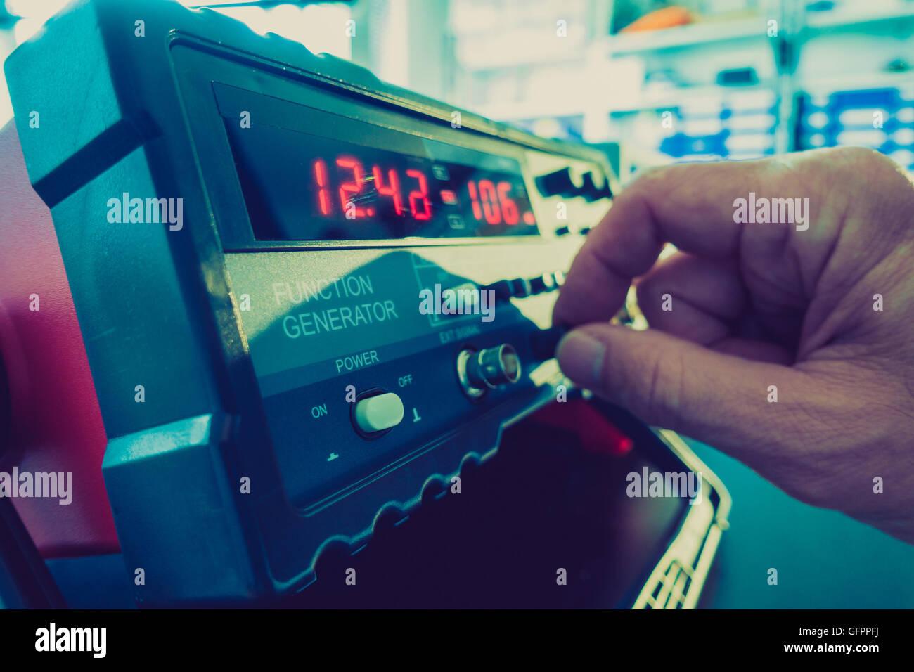 Ajust the function generator, electronic measuring instruments - Stock Image