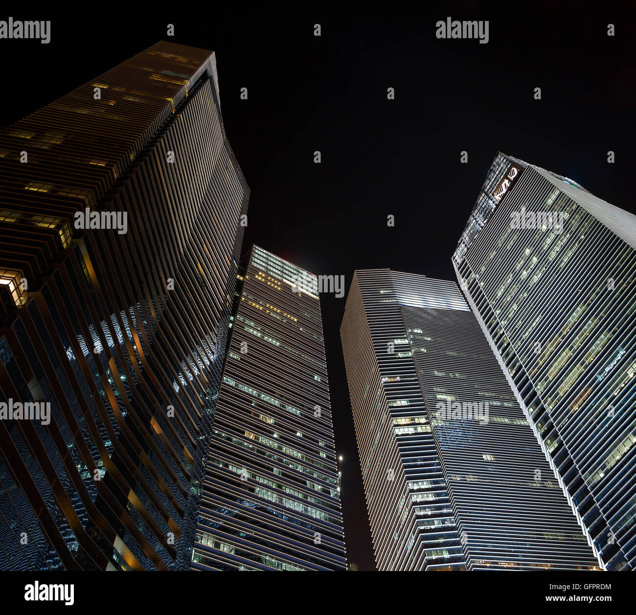 Shot Looking Up At Modern Office Buildings Stock Photo