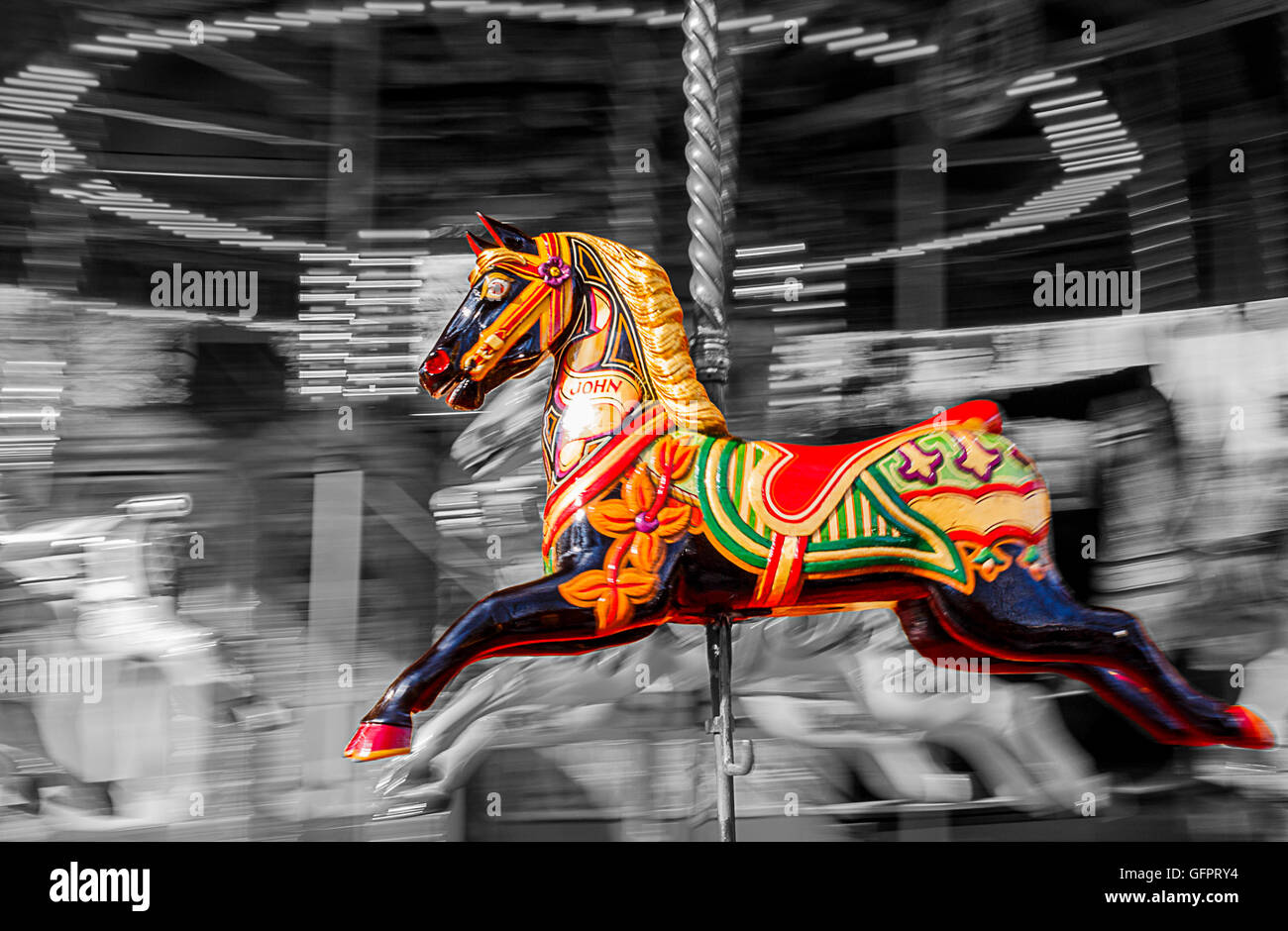 A Carousel Horse In Colour Isolated Against A Black And White Stock Photo Alamy