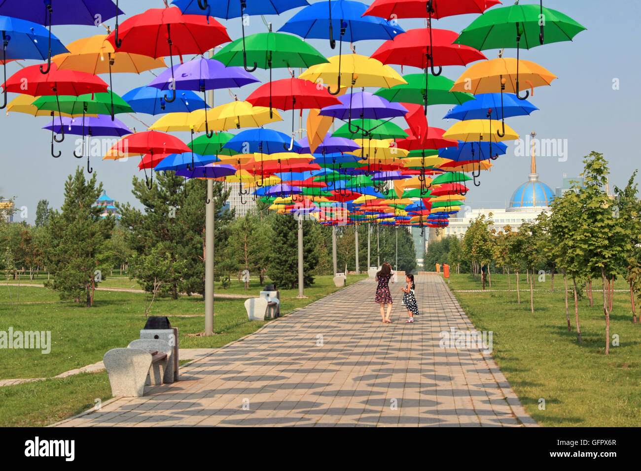 ASTANA, KAZAKHSTAN - JULY 07, 2016: art installation in the form of multicolored umbrellas in the central park of - Stock Image