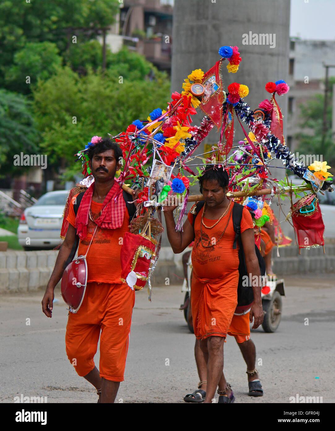 The Kānvar Yatrā or Kavad Yatra is an annual pilgrimage of devotees of Shiva, known as Kānvarias, to Hindu pilgrimage Stock Photo