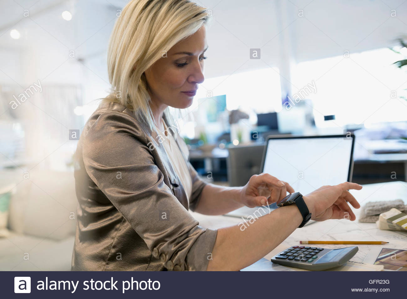 Interior designer checking smart watch - Stock Image