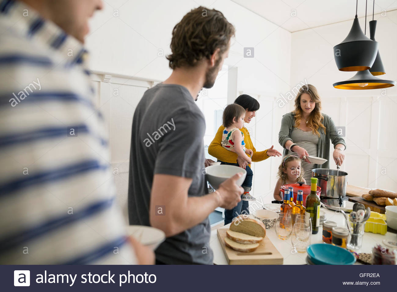 Families enjoying lunch buffet in dining room - Stock Image