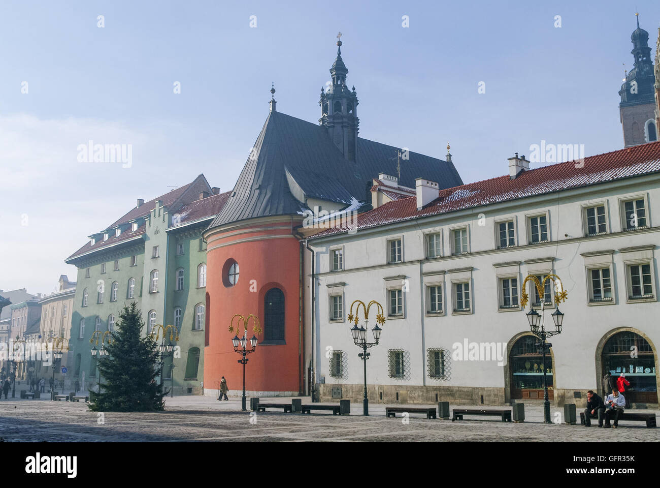 Krakow, Poland - January 6, 2011: The rounded coral-colour choir of St. Barbara's church flanked by 17-18th - Stock Image