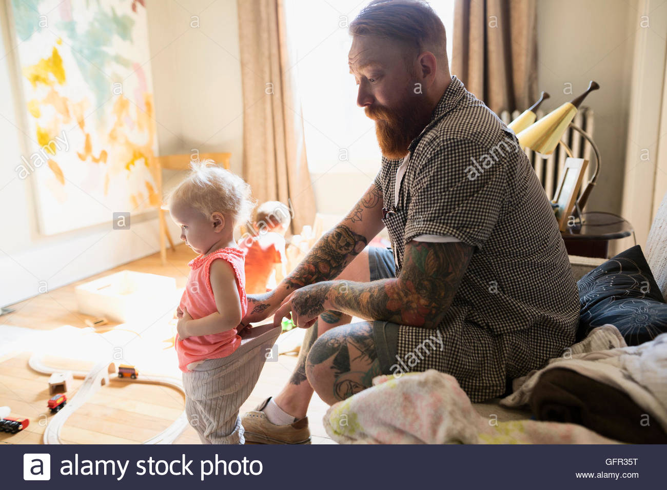 Father checking daughter - Stock Image