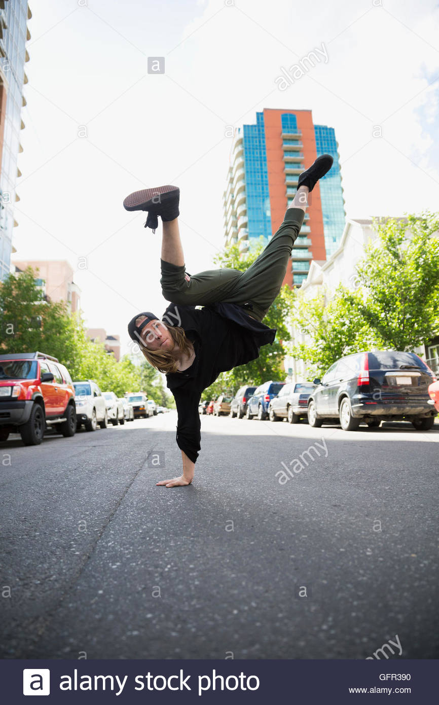 Cool young man free running in urban street - Stock Image