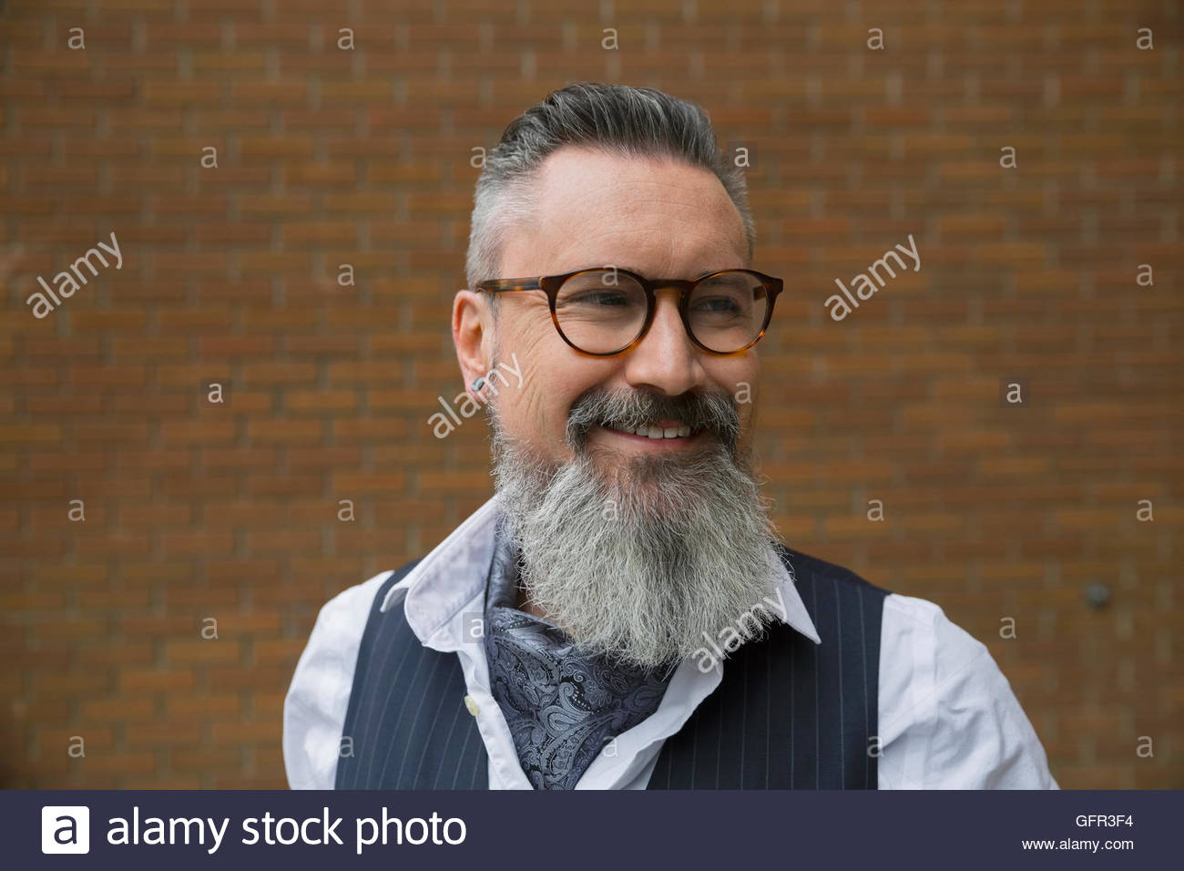 3005d8835c81 Portrait smiling cool hipster with gray beard and eyeglasses - Stock Image