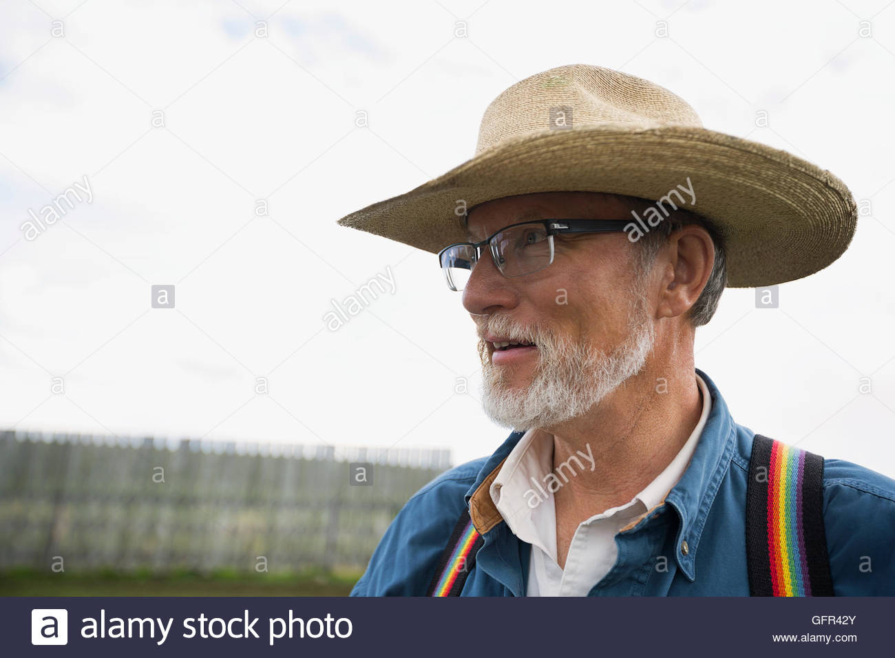 Senior cattle rancher in cowboy hat and suspenders - Stock Image
