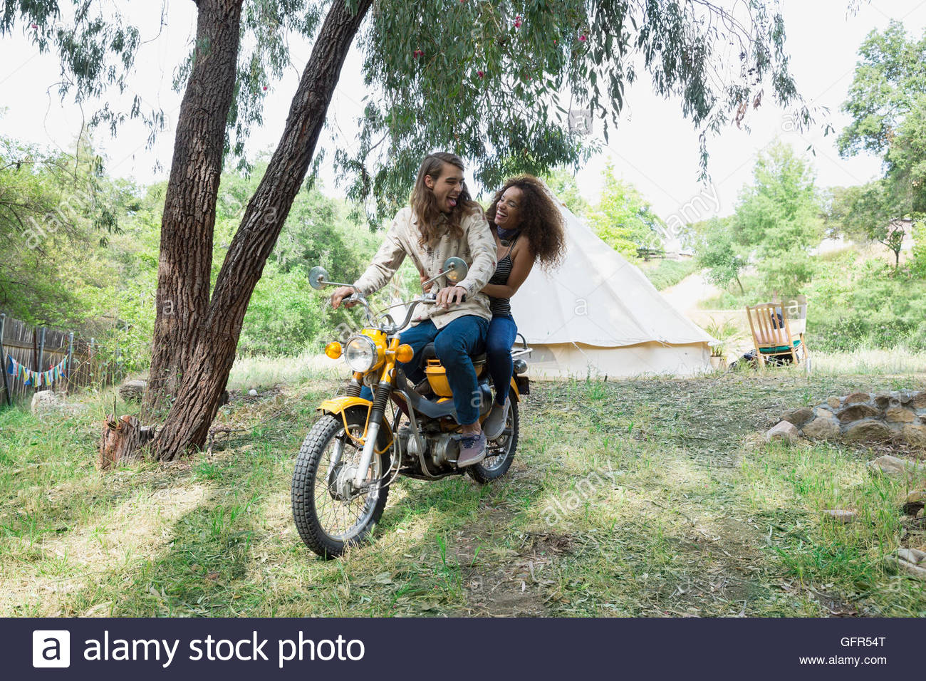 Young couple writing motorcycle outside c&ing yurt - Stock Image & Motorcycle Tent Stock Photos u0026 Motorcycle Tent Stock Images - Alamy