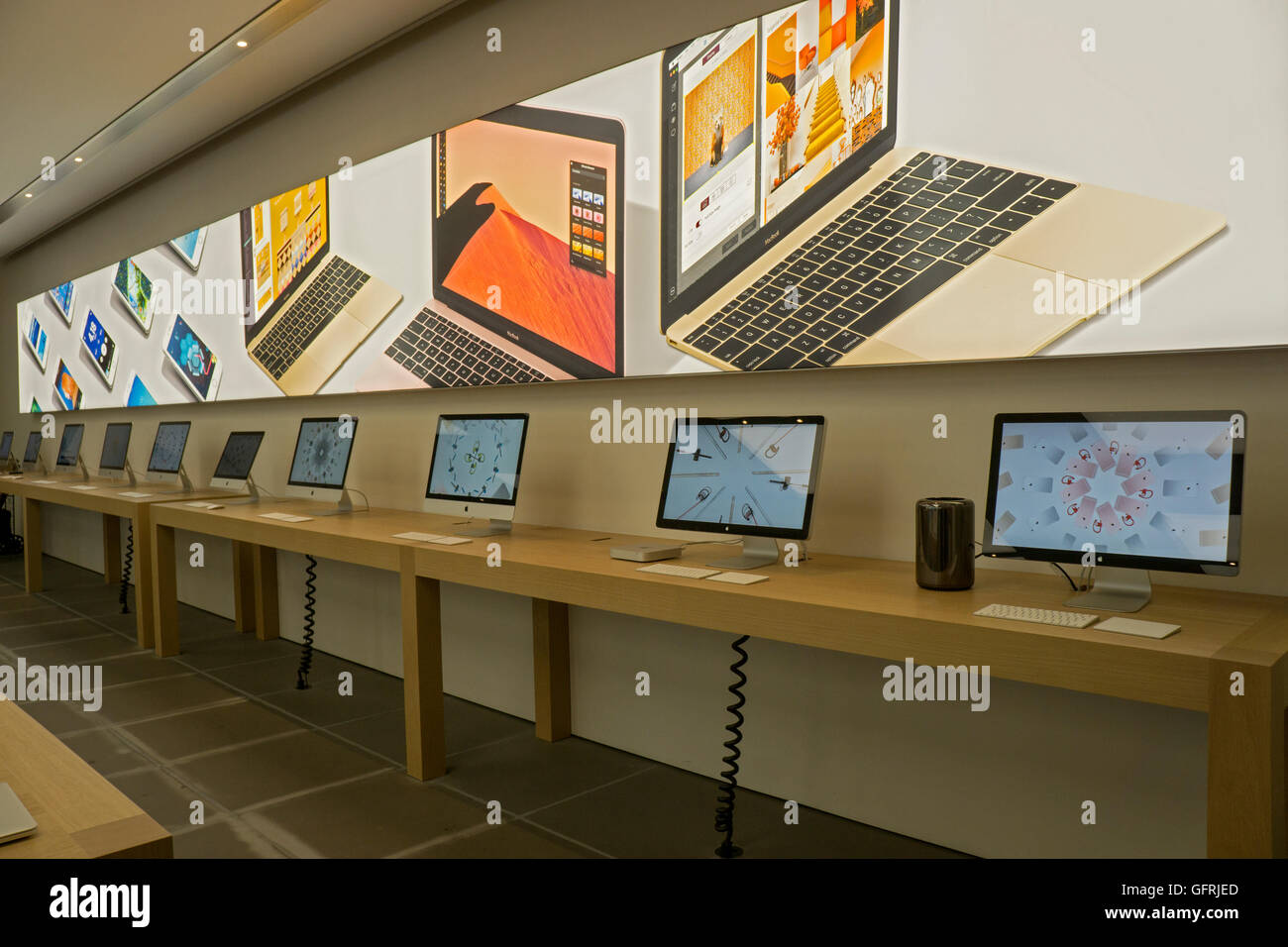 Computers for sale at the Apple store on Prince Street in the Soho section of lower Manhattan, New York City. - Stock Image
