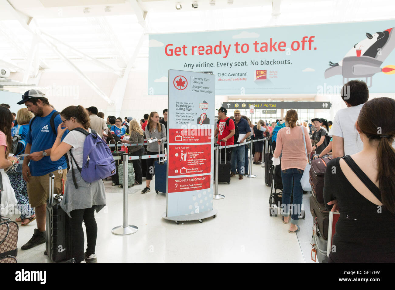 Air Canada check in and long queues at Toronto Pearson International airport, Canada - Stock Image