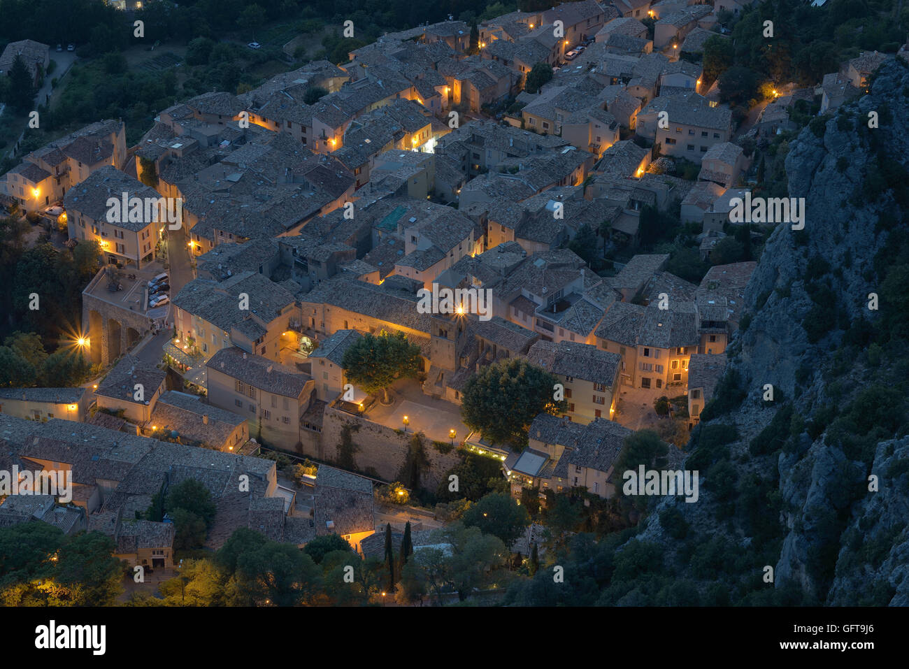 MOUSTIERS-SAINTE-MARIE AT NIGHT FROM AN ELEVATED VIEW POINT. Provence, France. Stock Photo