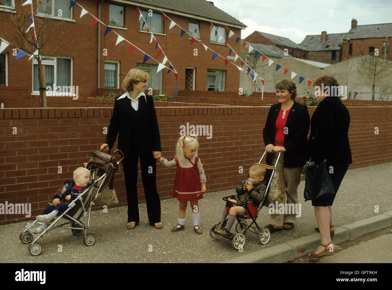 Troubles Northern Ireland Protestant family women chatting in street Belfast  1980s HOMER SYKES - Stock Image