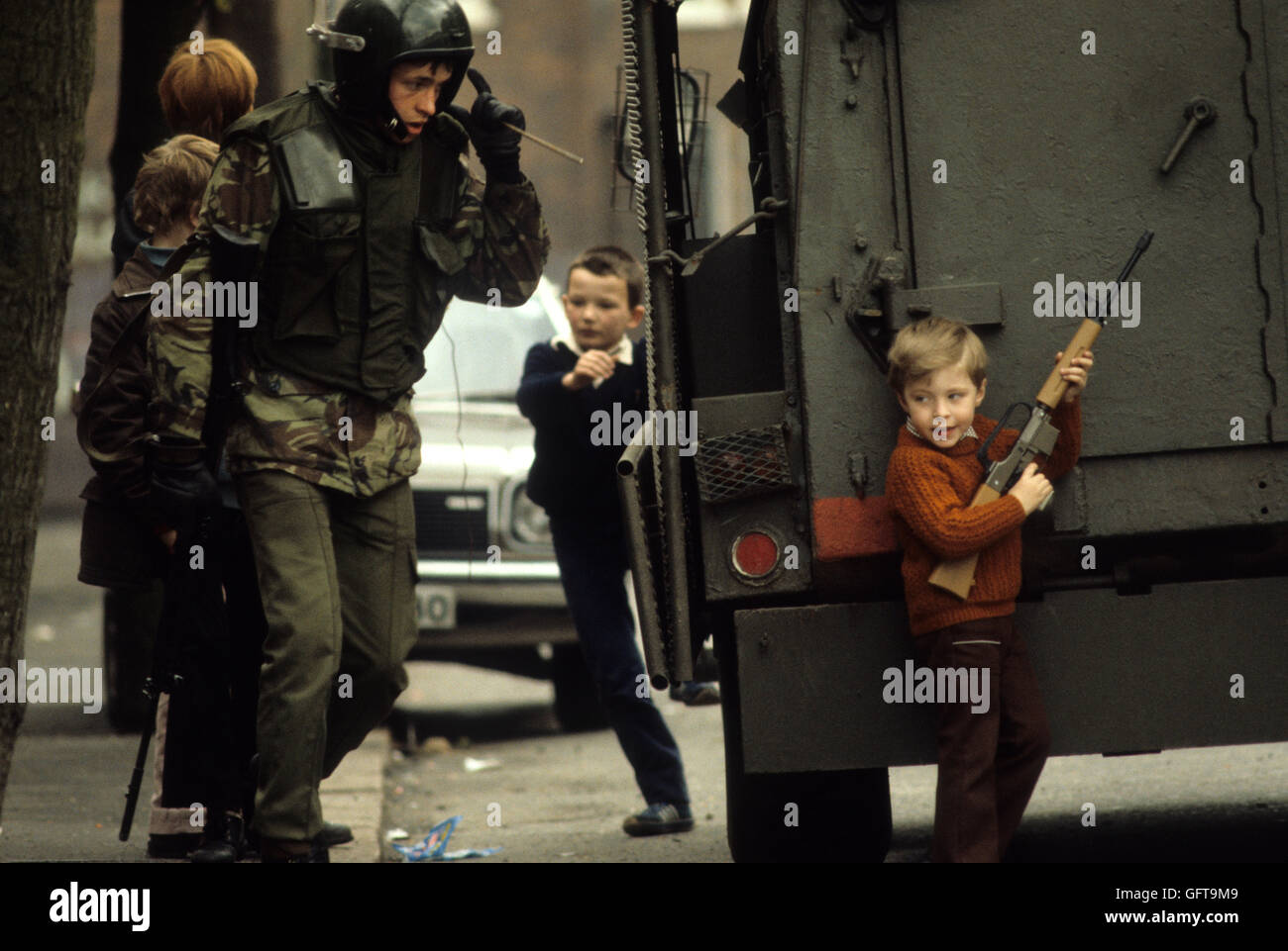 Kids children playing guns, during The Troubles Belfast Northern Ireland Conflict  1980s HOMER SYKES - Stock Image