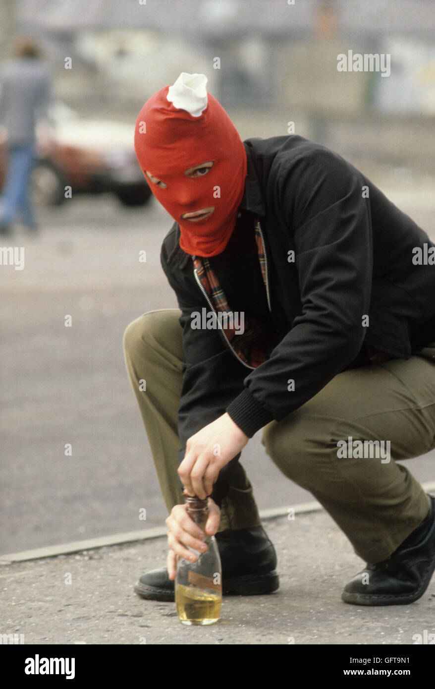 Riot Riots rioting Catholic youth IRA attacking the British army Belfast Northern Ireland Uk conflict  1980s  HOMER - Stock Image