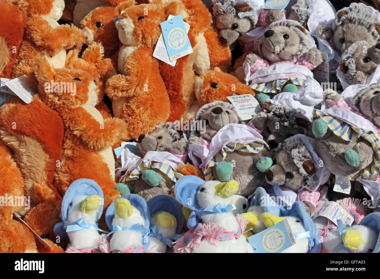 Basket of Beatrix Potter character dolls outside shop - Stock Image