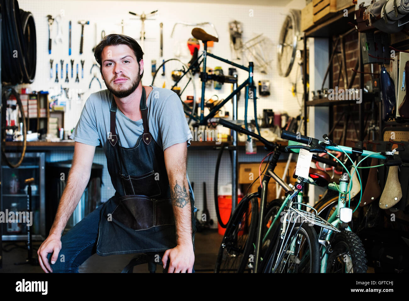 A man working in a bicycle repair shop Stock Photo